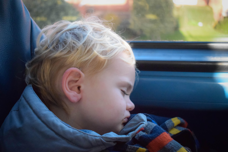 Boy asleep on bus