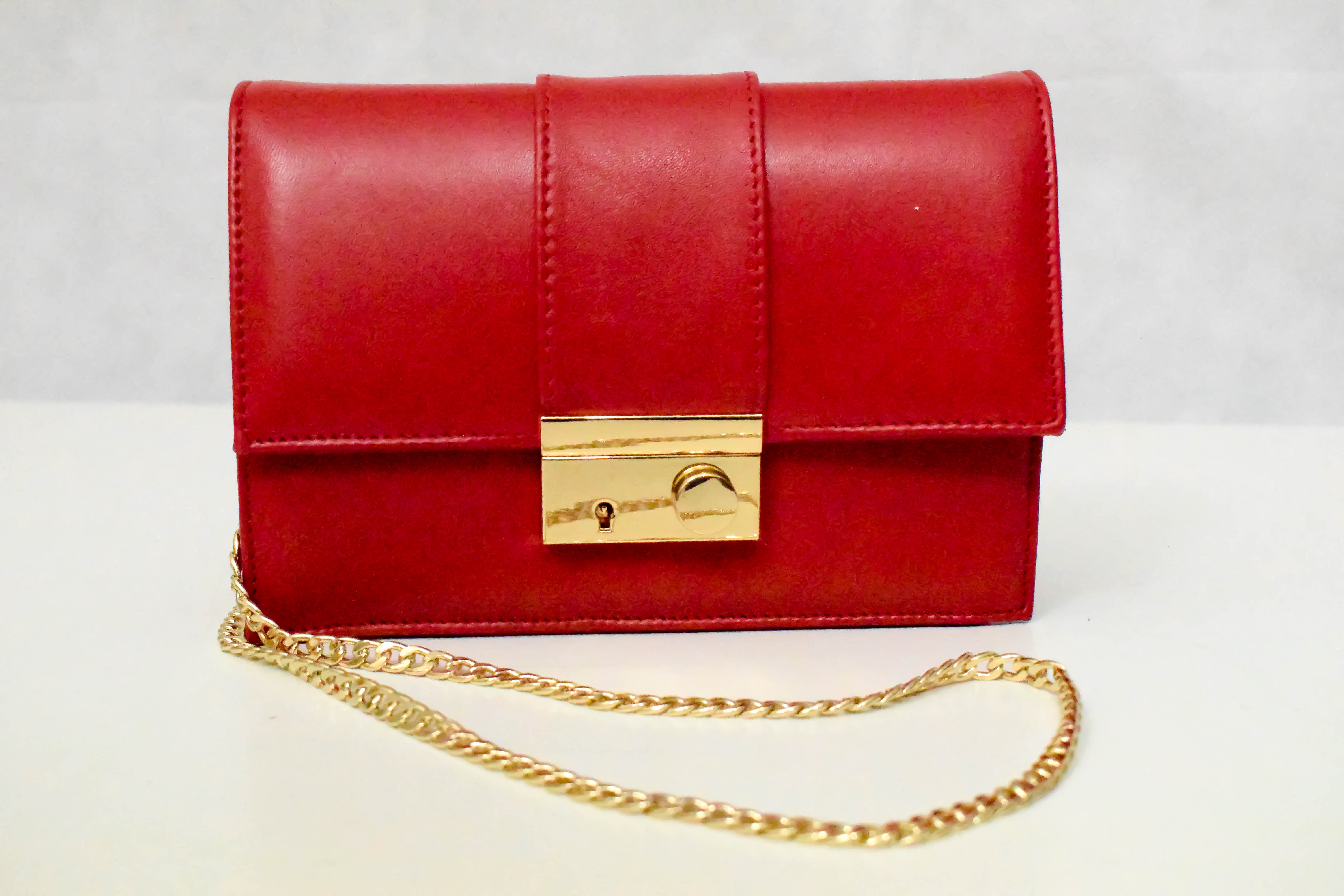 red leather handbag with gold chain