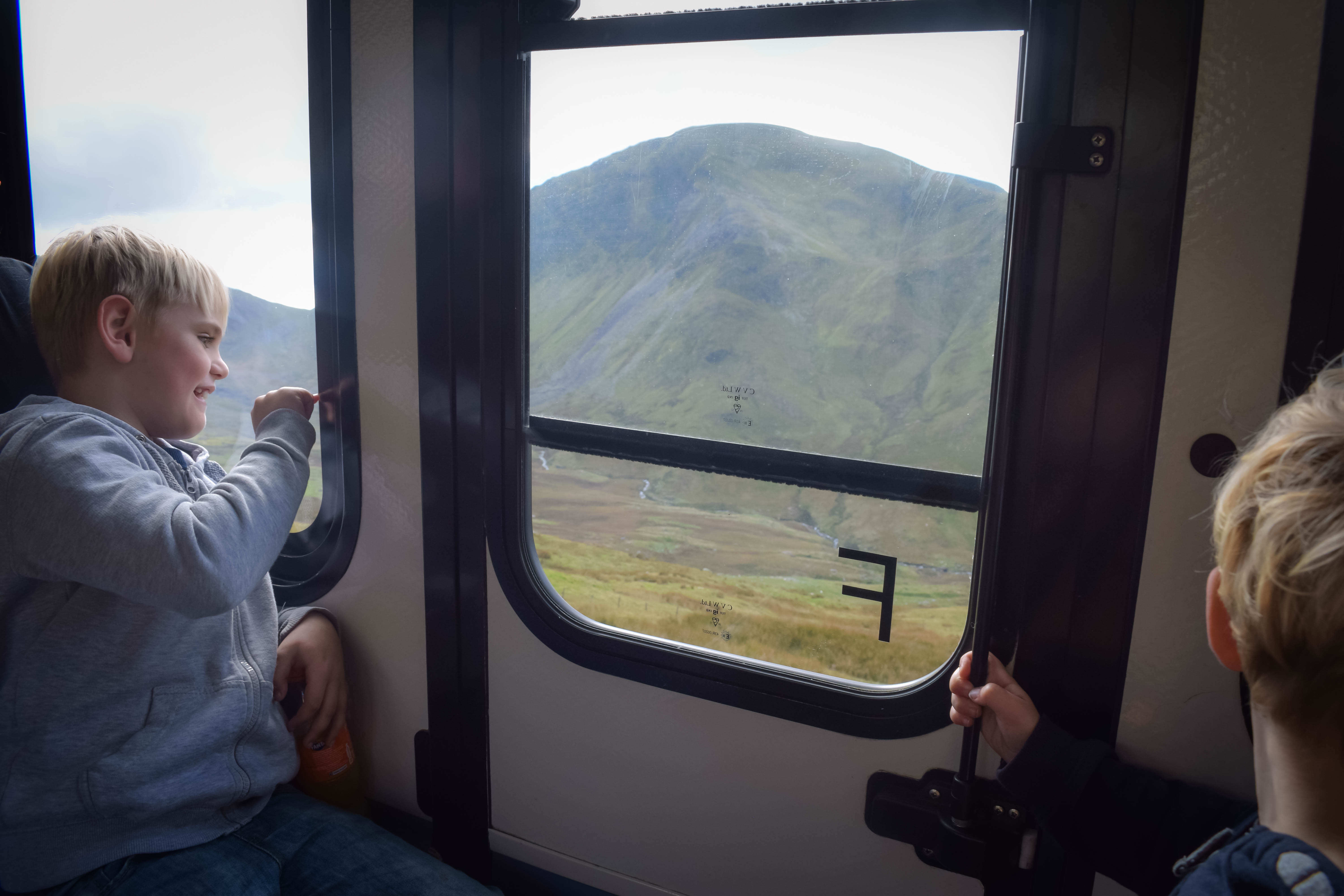 Children looking out of window at Views from Snowdon Mountain Railway