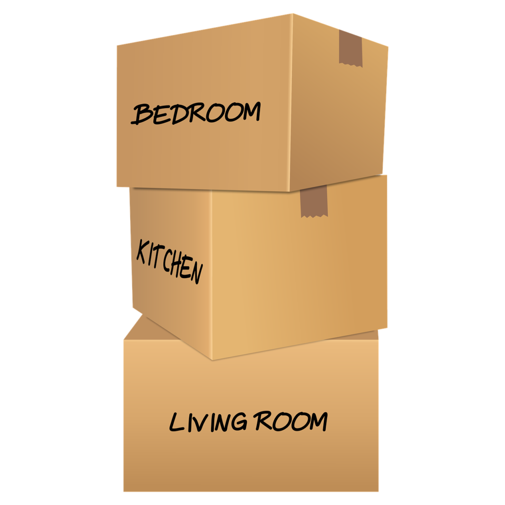 Cardboard boxes, differently labeled according to the room where the things that are inside the box will be placed.