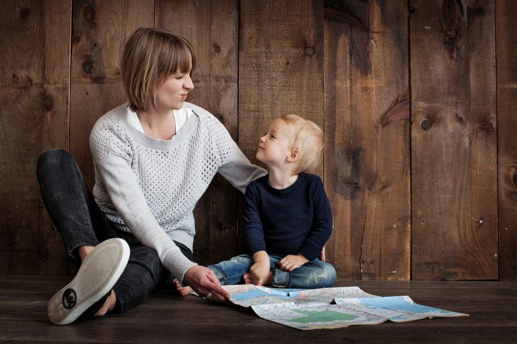 A child and its mother joyously communicating.