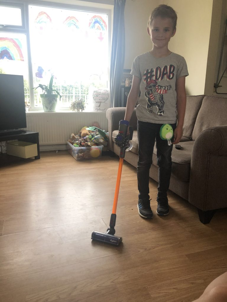 Male child playing with the Casdon Dyson Cord-Free Replica Vacuum
